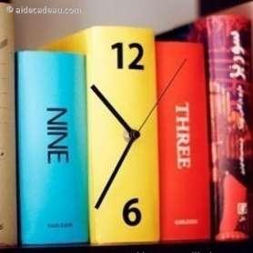 Horloge murale trois livres