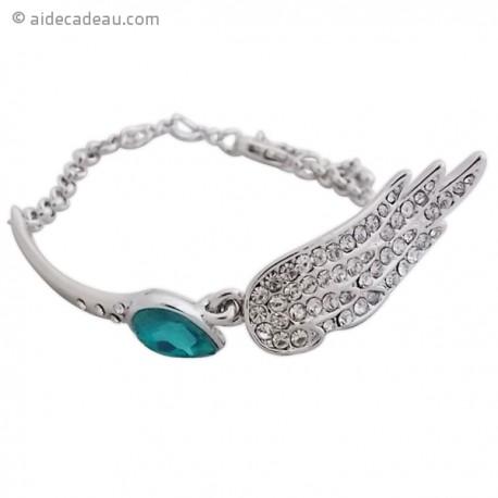 Bracelet aile argenté serti de strass et d'une grosse pierre bleu
