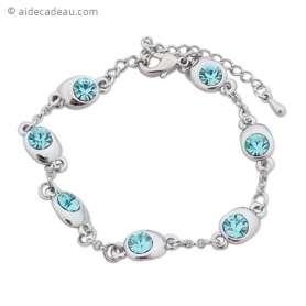 Bracelet fantaisie argenté, agrémenté de 7 petites pierres bleu cie