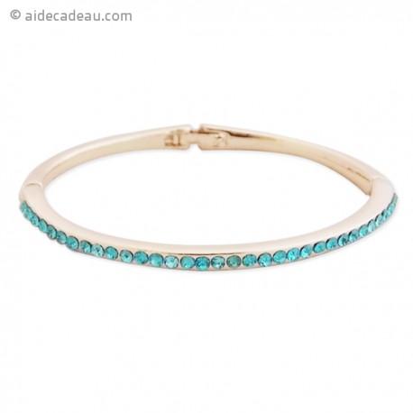 Joli bracelet doré serti de plusieurs petites pierres bleues