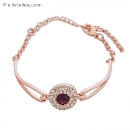 Bracelet doré avec un cercle de strass et faux cristal violet