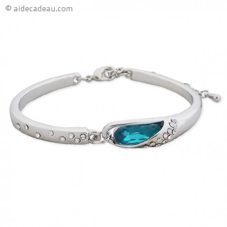 Splendide bracelet rigide de couleur argentée, serti de pierre bleue