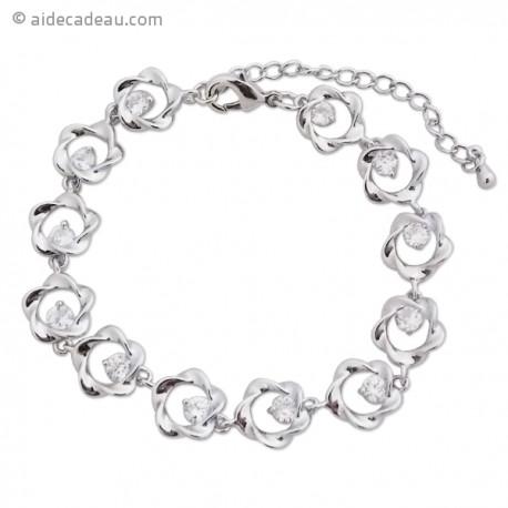 Le bracelet petites fleurs argentées et faux cristaux blancs