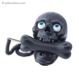 Téléphone fixe en forme de tête de mort et os