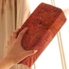 Coussin pavé de brique rouge