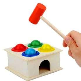 Jouet à taper au marteau avec boules colorées