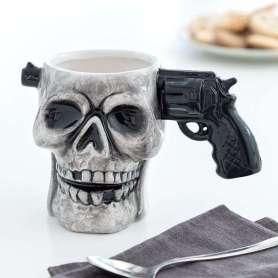Tasse en forme de tête de mort anse pistolet