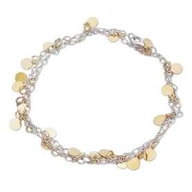 Bracelet argenté orné de plusieurs petites plaques rondes