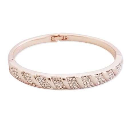 Bracelet doré avec motifs argentés en strass