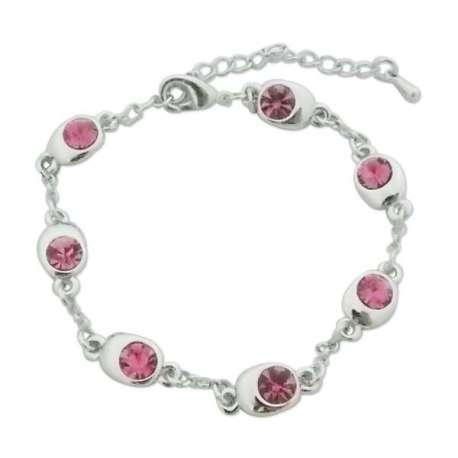 Bracelet argenté: bijoux ovales et faux cristaux roses