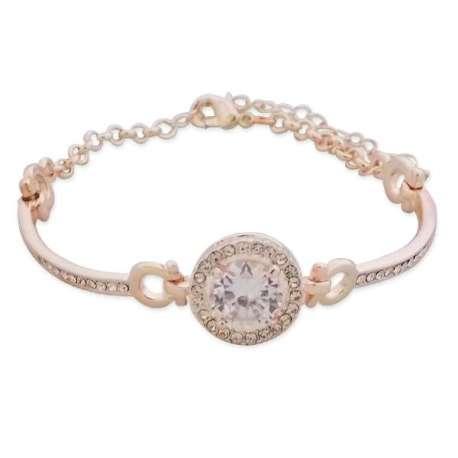 Bracelet doré avec un gros faux cristal blanc